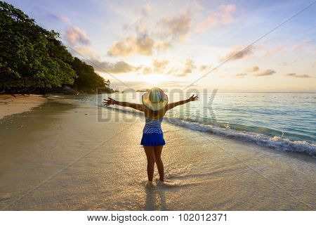 Happy Girl On The Beach At Sunrise