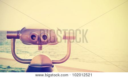 Vintage Toned Photo Of A Binocular Pointed At Horizon, Copy Space.