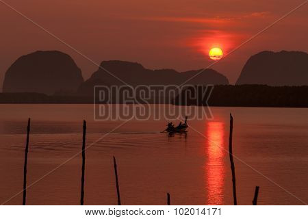 Silhouette Of Fisherman And Traditional Thai Boats At Sam Chong Tai, Phang Nga Province.