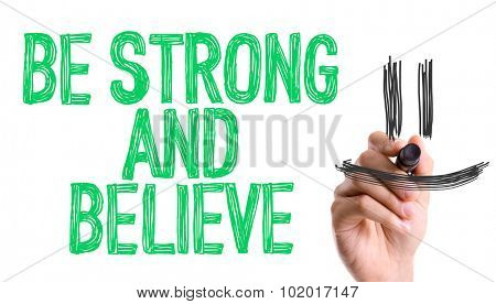Hand with marker writing: Be Strong and Believe