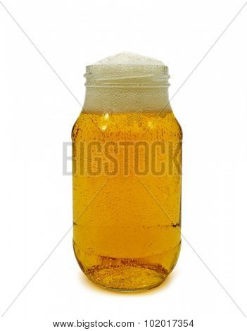 refreshing beer served in a glass jar on a white background