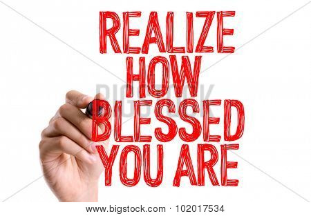 Hand with marker writing: Realize How Blessed You Are