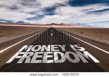 Money is Freedom written on desert road