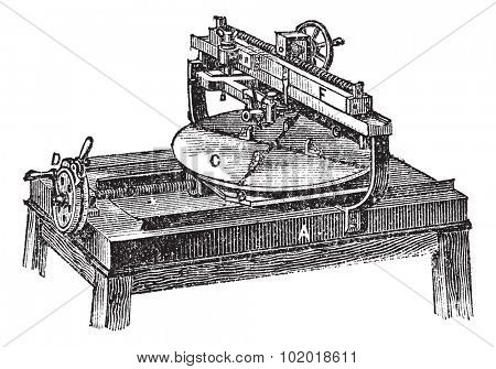 Engraving machine, vintage engraving. Old engraved illustration of Engraving machine with its functioning parts, isolated on a white background. Trousset Encyclopedia.