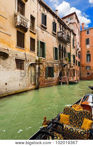 Canal And Gondola In Venice - Italy