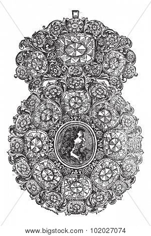 Old engraved illustration of Brooch with portrait in it from the work of jewels J. B. F., 1723, isolated on a white background. Industrial encyclopedia E.-O. Lami - 1875.