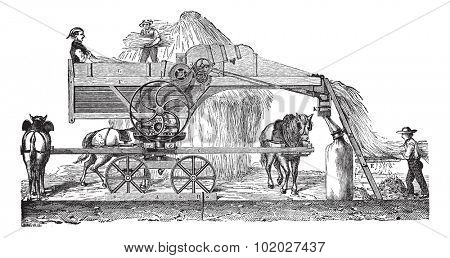 Old engraved illustration of Threshing machine or thrashing machine in the field. Industrial encyclopedia E.-O. Lami - 1875.