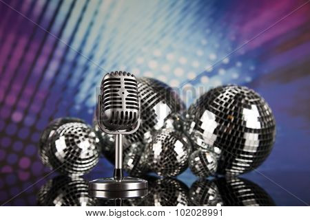 Music background, microphone and Disco Balls