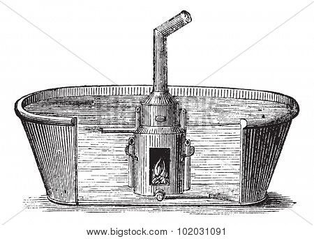 Bath with mobile device to heat water in a large bath 45 minutes with charcoal, vintage engraved illustration. Usual Medicine Dictionary - Paul Labarthe - 1885.