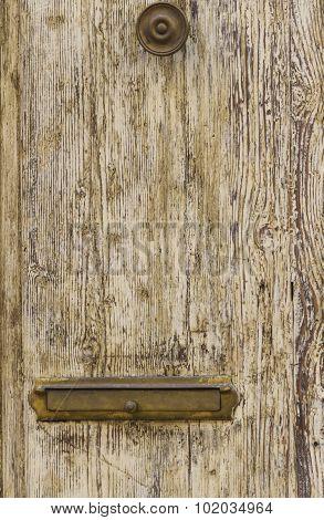 Old Postbox On Wooden Door
