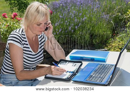 Middle Aged Woman In Home Office Outdoors