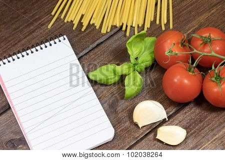 Vegetable, Pasta And Paper Notebook On The Wooden Table