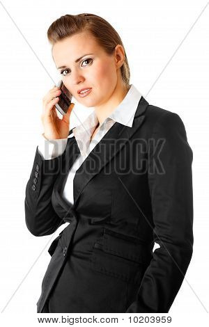 pensive modern business woman  with mobile phone
