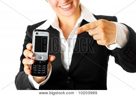smiling modern business woman pointing  finger on  mobile phone