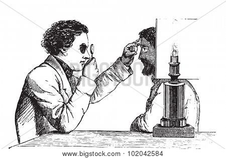 The merits of the eye, the image reversed, using a simple hand ophthalmoscope, vintage engraved illustration. Usual Medicine Dictionary - Paul Labarthe - 1885.