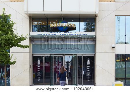 LONDON, UK - AUGUST 17: Woman approaching entrance of Universal Music Group International building in High Street Kensington. August 17, 2015 in London.