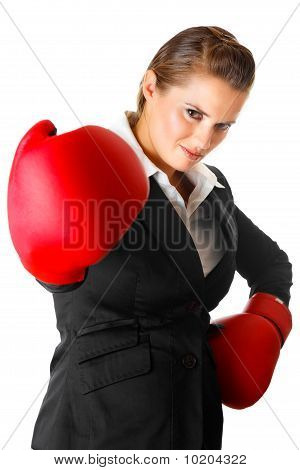 confident modern business woman with boxing gloves