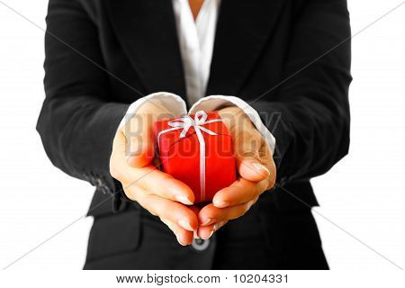 modern business woman holding gift in hands .  Close-up