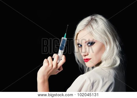 Beautiful Young Girl In The Image Of Nurse With Syringe In Hand