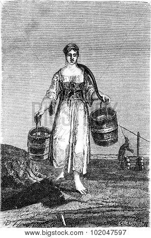 A young girl carrying water in Nennal, vintage engraved illustration. Le Tour du Monde, Travel Journal, (1865).