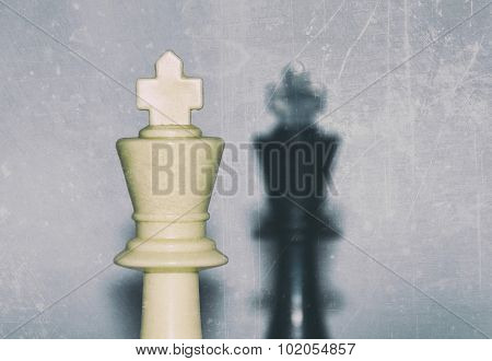 face to face - two kings, black and white plastic chess pieces - selective focus