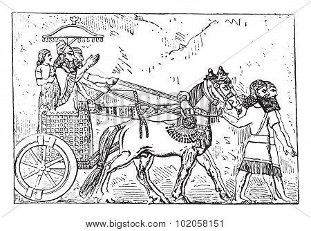 Ashurbanipal on his chariot, vintage engraved illustration.