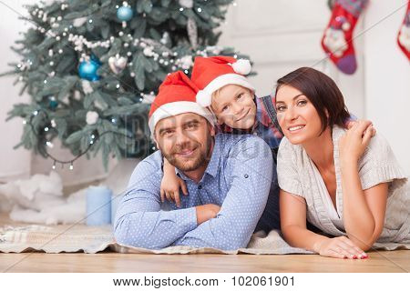 Cheerful friendly family is celebrating New Year