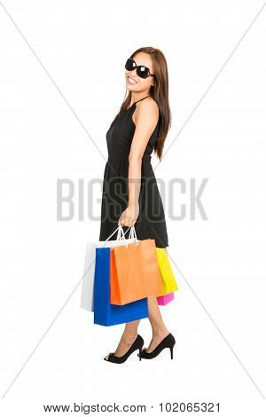 Relaxed Standing Female Shopper Shopping Bags Side