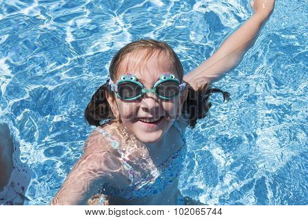 Smiling Girl Enjoying The Pool In Summer