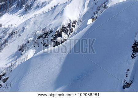 Snowy mountain slope. Winter landscape