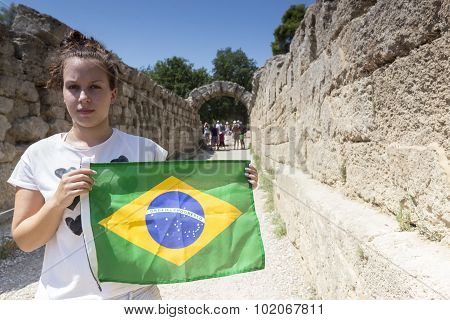 Girl Holds The Brazilian Flag For The Next Olympics At Olympia Birthplace Of The Olympic Games, In G