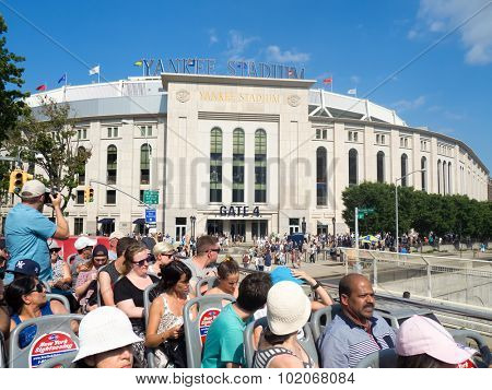 NEW YORK,USA - AUGUST 19,2015 : Torists at a bus looking at the Yankee Stadium in The Bronx