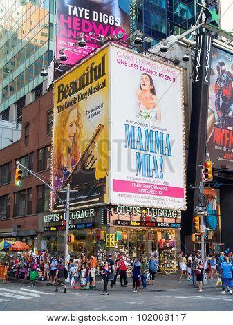 NEW YORK,USA - AUGUST 14,2015 : People and bllboards advertising Broadway musicals near Times Square in New York City