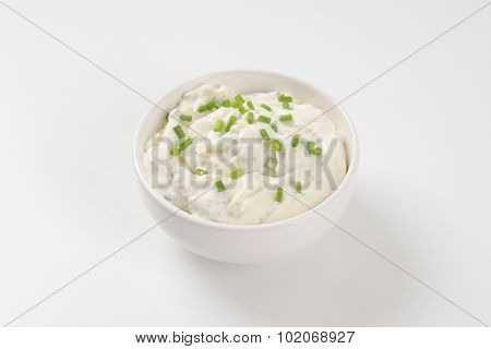 bowl of chives spread on white background