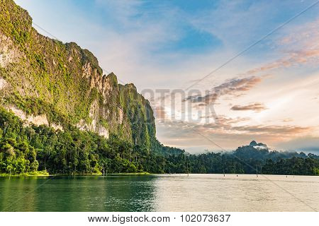 Lake And Cliff And Morning Sky