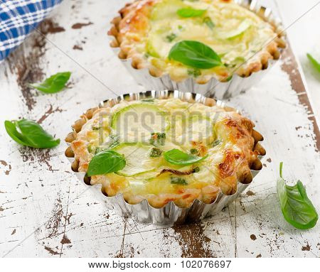 Tarts With Zucchini And Cheese On A Wooden Background.