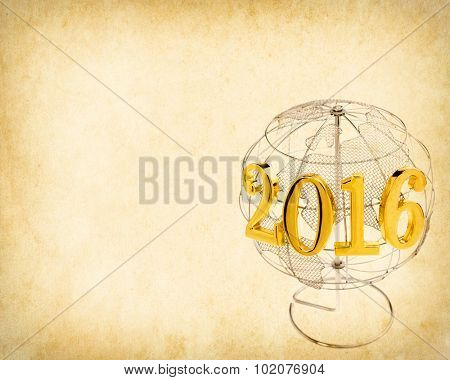 New Year 2016 with earth on Old antique vintage paper background
