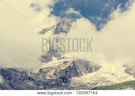 Mountain peak covered with clouds