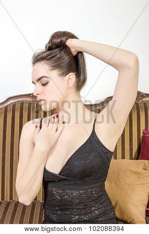 Sensual Elegant Woman  Posing On Sofa