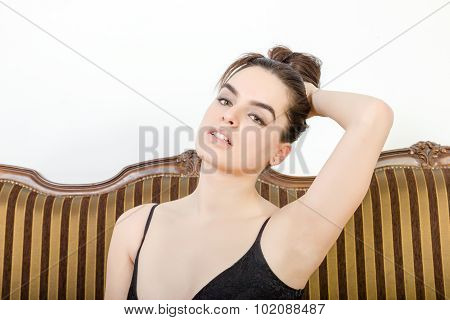 Beautiful Sexy Person  Indoor Lifts Up Hair, Looking Seductive