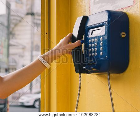 Female Hand Holds Up The Phone
