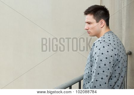 Young Man At Balcony In Depression Sufferin