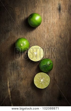 Organic Lime On Rustic Wood Board Background, Still Life Photography With Lime On Wood Board Backgro