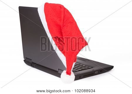 Red Santa Hat On The Notebook Computer