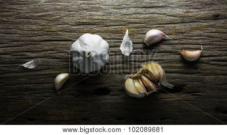 Organic Garlic Bulbs On Rustic Wooden Background, Still Life Photography With Garlics On Wooden Back