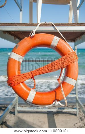 Orange Life Preserver On A Beach