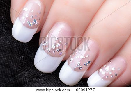 Nails With A French Manicure And Silver Tinsel