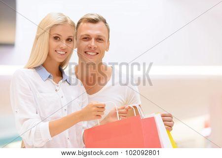 Upbeat couple doing shopping