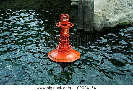The Red Buoy On Water