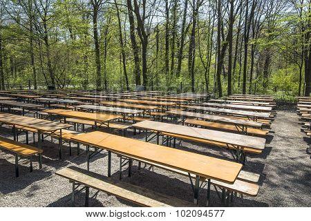 Empty Beergarden Tables In The English Garden In Munich